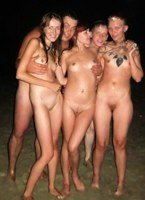 Hardcore chicks enjoy skinny dipping at a lake with friends